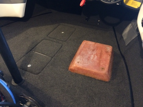 Ice box and battery box covers are the pieces in the middle. The fiberglass sticking up is the base for the driver seat